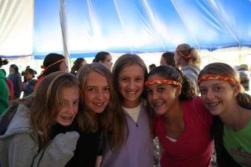 Girls Smile at Camper Worship